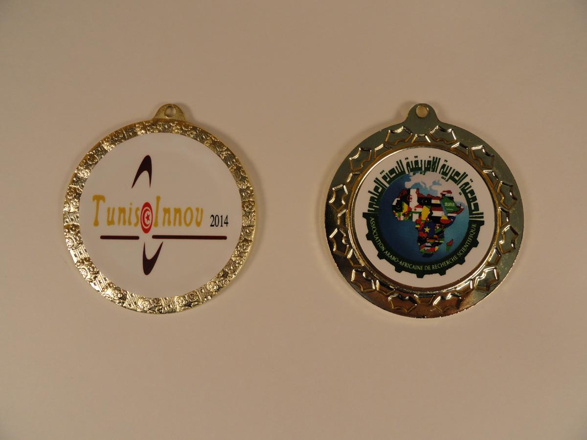 """Золотая медаль устройства """"АВЕРС-СТРИМ"""" за лучшее изобретение бытовой техники на Международной олимпиаде изобретений и инноваций в Тунисе (с 7 по 18 марта 2014 года)"""
